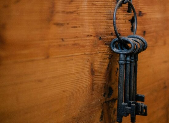 keys on a wooden wall to indicate the key sales metrics